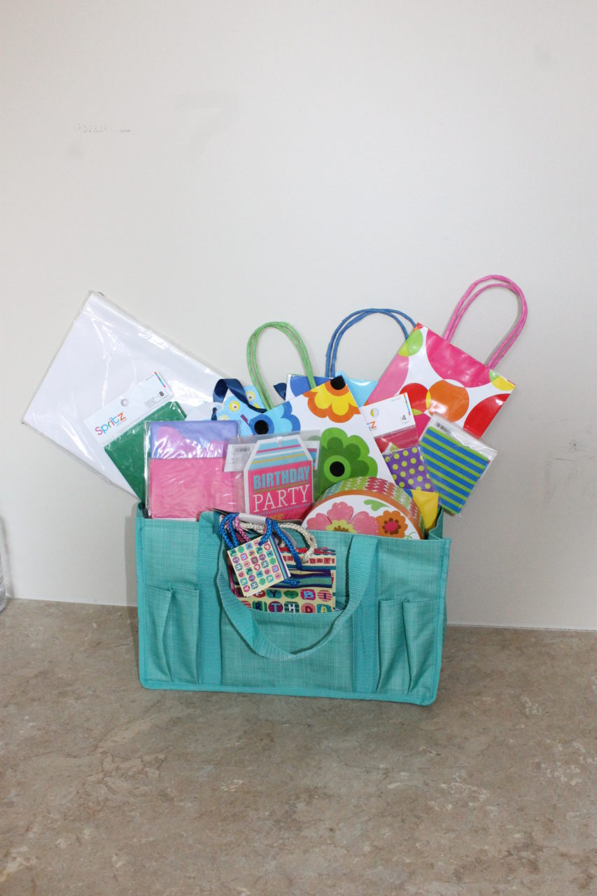 """Gift Bag Basket  (5) small gift bags, flower box gift holder, """"Party"""" gift tag,  (2) packages of gift tags 4 in each, 8pk of Pink Blank Notecards, (2) Large gift bags, (2) packs of tissue paper all inside a Thirty"""